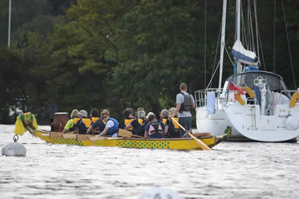 Helms eased the Dragon Boats through the moorings near Belle Isle.