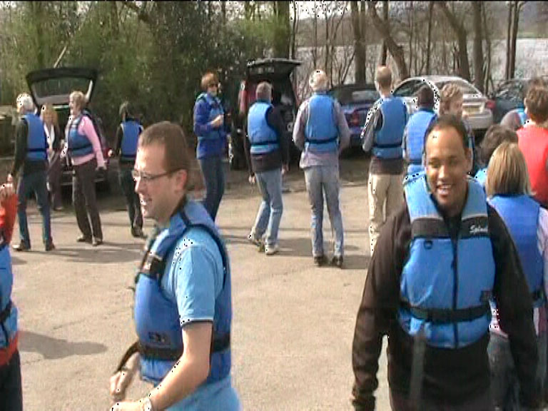 New paddlers warm up before paddling in a dragon boat.