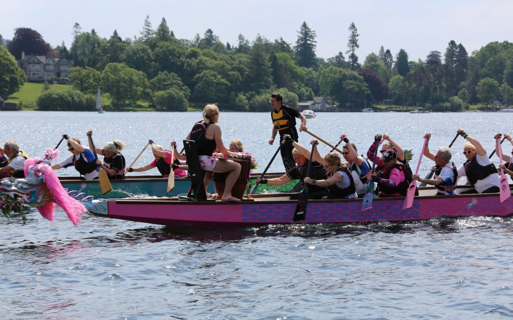Two teams race as Keni coaches paddlers.