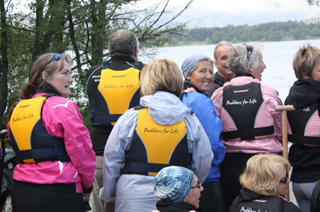 Paddlers show of their new Crewsaver Buoyancy Aids complete with our name!