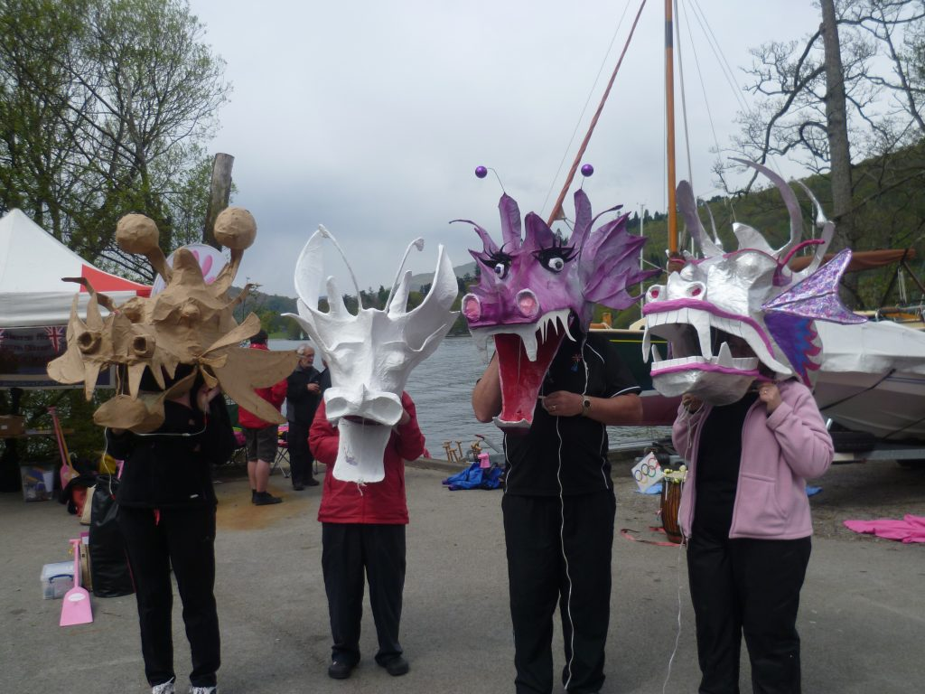 Members try out the newly painted dragon puppet heads in 2012.
