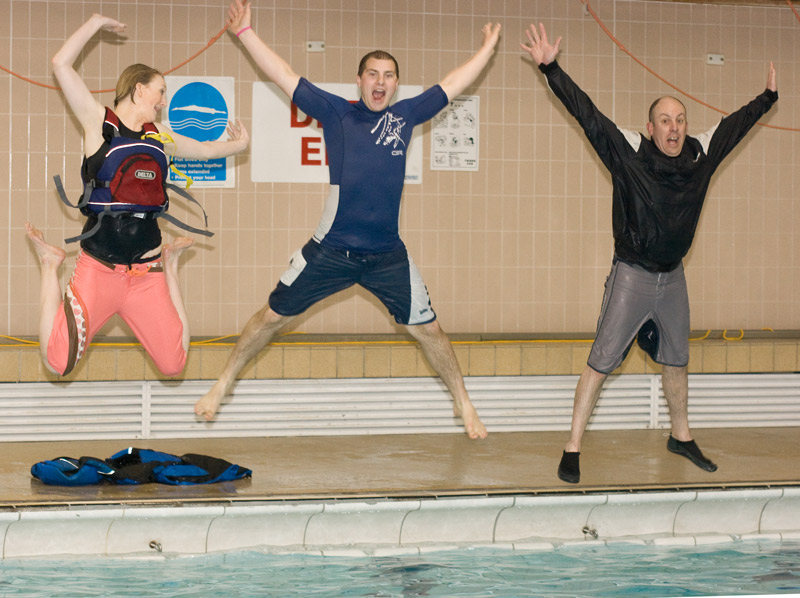Instructors celebrate a successful water confidence session.