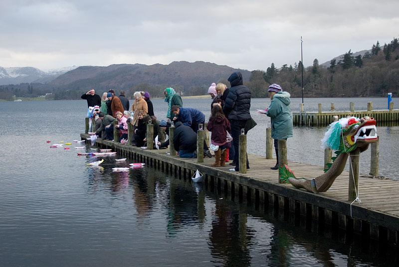 Launch of paper dragon boats from the jetty on to Windermere,