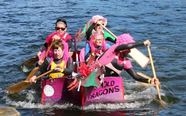 Paddling the cardboard boat over a figure of eight course.