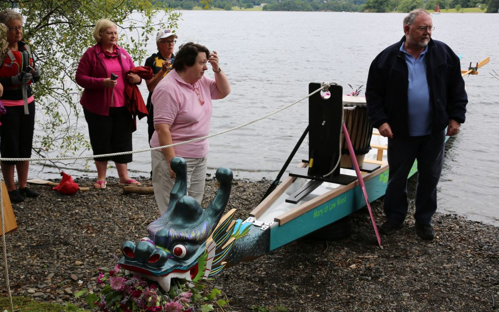 Pauline and Jim 'dotted the eyes' of the new dragon boat.