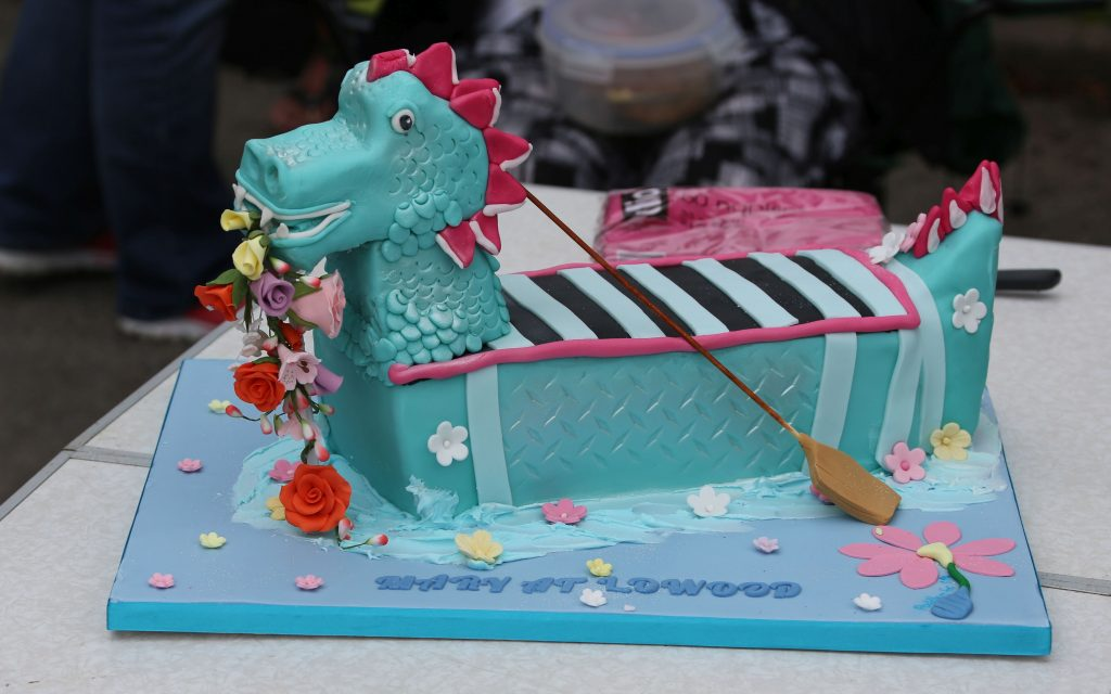 A 'Thank you' cake in the shape of a dragon boat acknowledged the generous bequest that purchased the boat..