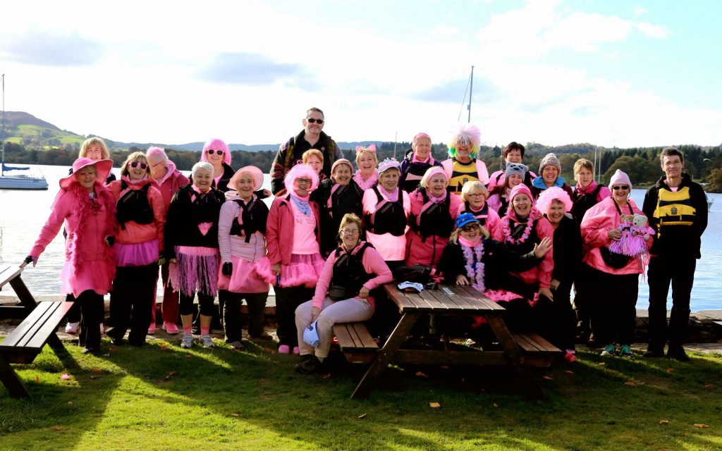 Paddle in Pink for breast cancer awareness .