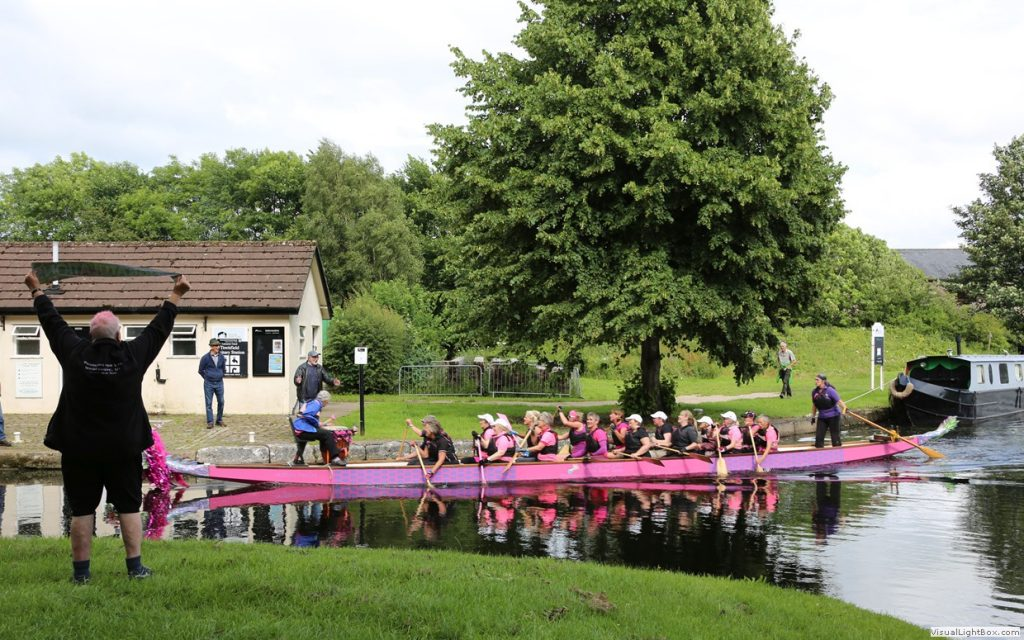 A team from Paddlers for Life Windermere pull into the canal basin at Tewitfield after paddling a dragon boat in relay teams.
