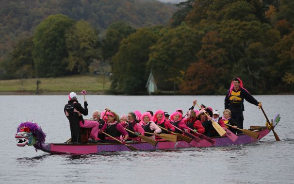 Paddlers dressed in pink to promote breast cancer awareness.