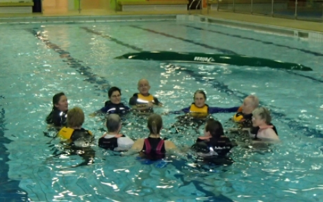 Supporting fellow paddlers in the water. Forming a circle for group support.