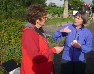 Sylvia Emmott and Mary Smith compare notes.