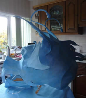 Work on the dragon head puppets continues.
