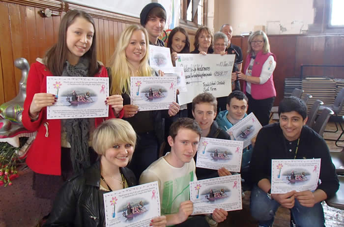 Proud students enjoy their success in fund raising.