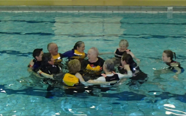 Supporting fellow paddlers in the water. Forming a circle for group support and to keep each other warm.