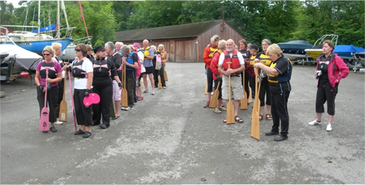 Visitors try out dragon boat paddling.