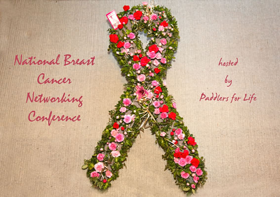 A breast cancer ribbon composed in pink flowers.