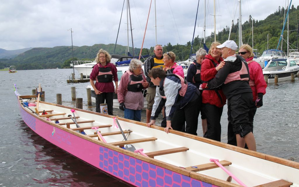 Learning how to load crew onto the dragon boat so that it is balanced in the water.