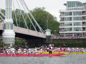 Paul at the helm in the early stages of the pageant near Chiswick.