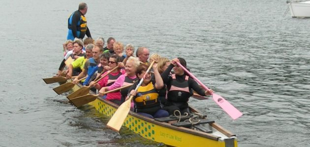 Dragon boat swamping exercise on Windermere for safety practice.