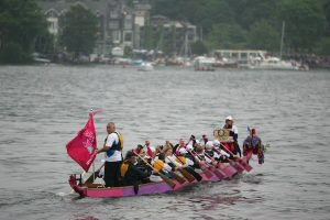 Paddlers for Life paddled two dragon boats accompanying the Olympic Torch on the Tern from Waterhead to Bowness-on-Windermere..
