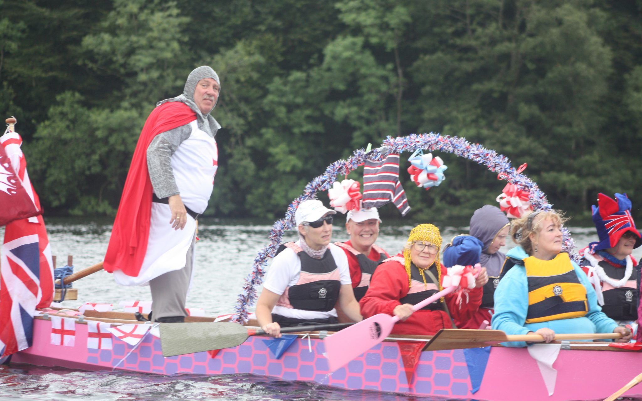 2013 and 'George' helms the dragon boat to Bowness.