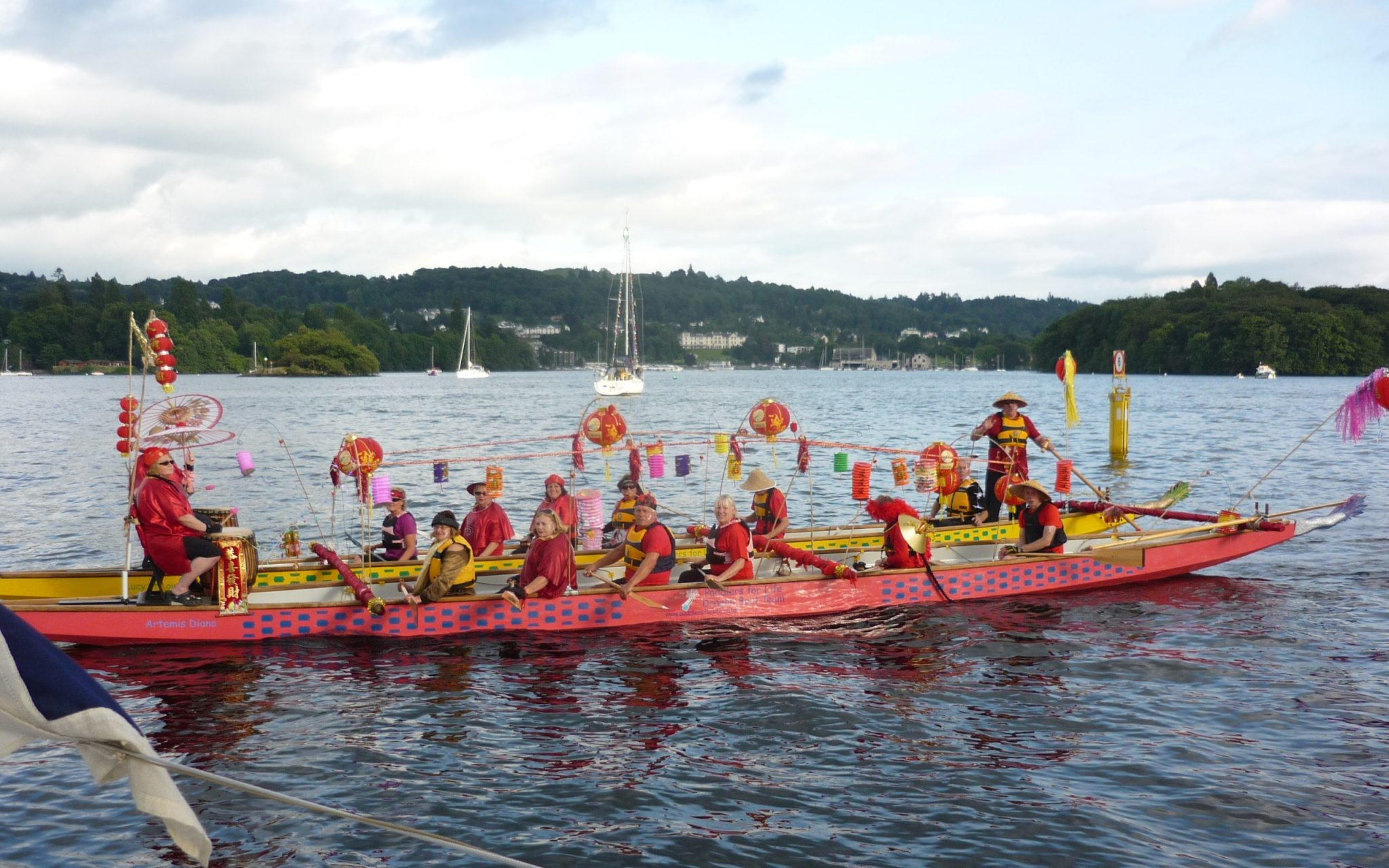 2010 and our first time with the best dressed boat competition organised by the Lake District Boat Club. We chose an oriental theme because we were paddling our dragon boat.
