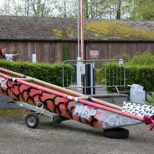The fully built and assembled cardboard dragon boat is ready to go.