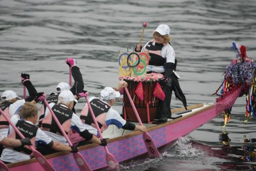 Our drummer raises morale as we rendezvous with The Tern carrying the Olympic Torch across Windermere in 2012.