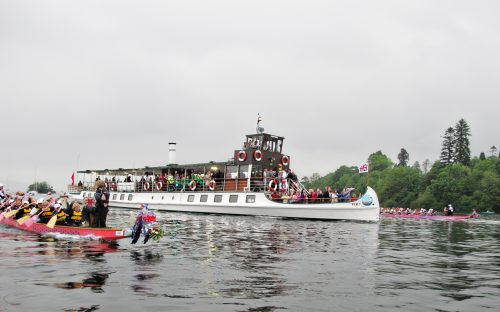 Our two dragon boats, Artemis Phyllis and Artemis Diana, at each side during the 2012 Olympic Torch relay.
