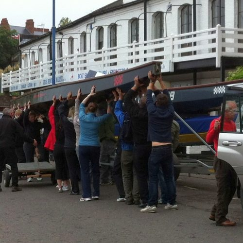 Paddlers for life help other team get their boats off the trailer at Putney with our two boats underneath.