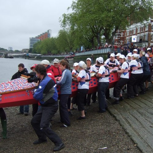 Getting the dragon boats onto the Thames at Putney.