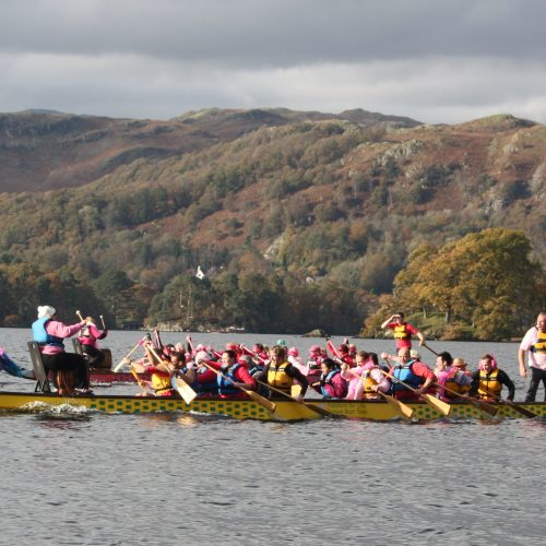 Paddle in pink finishes with a race against a crew of Low Wood staff in 2011.