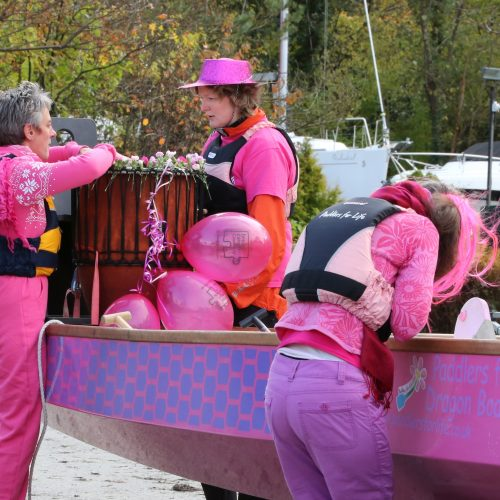 Preparing the dragon boat for a pink paddle 2012.