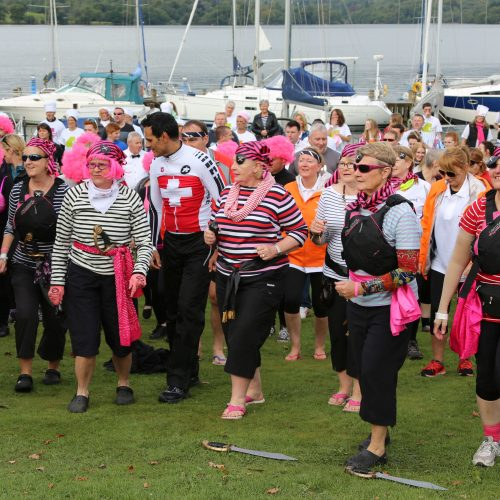 Paddlers for Life Windermere paddlers join the warm-up for the 2015 regatta along with many other paddlers from business groups and charities ready for their first taste of dragon boat racing..