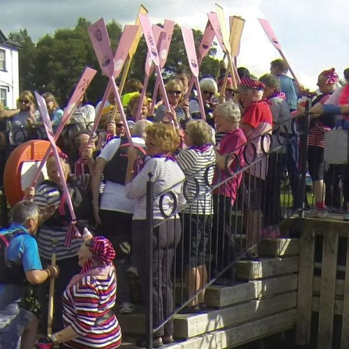 Paddlers for Life form a guard of honour for the winning team in 2015.