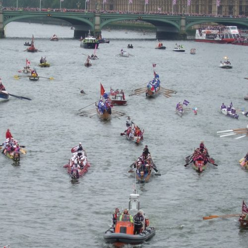 The front of the flotilla was a collection of human powered boats including a dozen dragon boats.