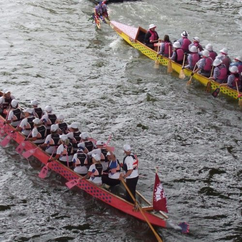 Our two dragon boats, Artemis Diana and Lucy at Low Wood, wait under Putney Bridge to join the start of the Queen's Diamond Jubilee Pageant in 2012.