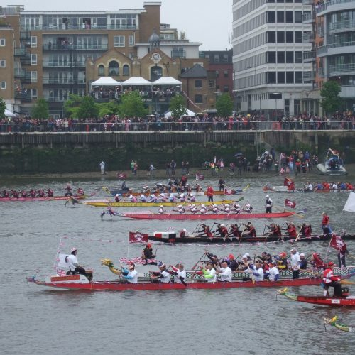 At the early stages of the pageant the dragon boat crews are getting into their stride. Artemis Diana had mostly survivor paddlers with a couple of supporters. Lucy at Low Wood was borrowed by the International Breast Cancer Paddler's Commission and crewed by an international team of breast cancer paddlers.