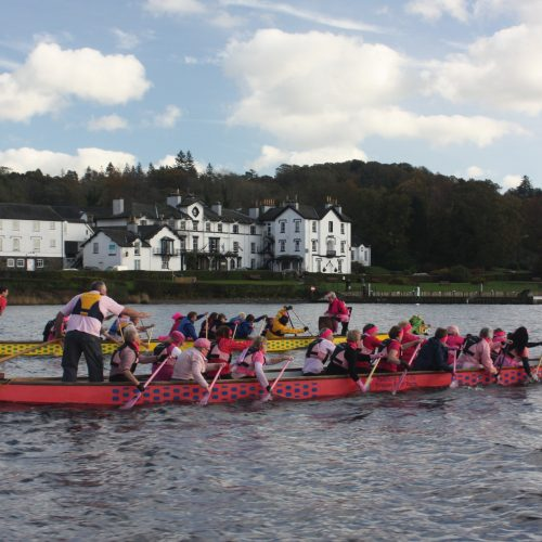 Who is leading in the 'Pink Paddle' race between Paddlers for Life and Low Wood Hotel staff.2011